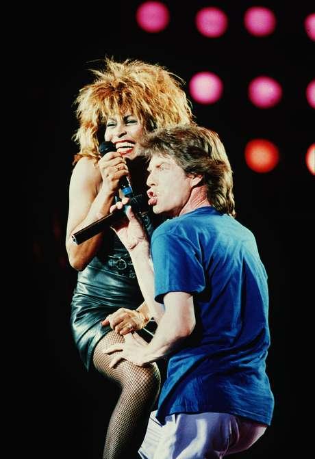 Tina Turner y Mick Jagger en una postal clásica del Live Aid