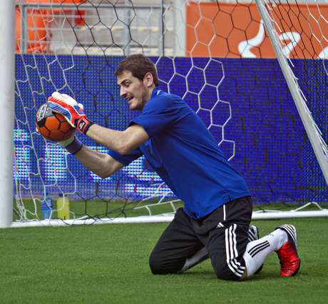 Spanish national team goalie Iker Casillas helps make a save in Houston.
