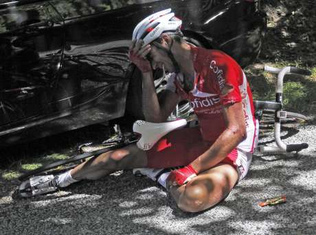 Cofidis rider David Moncoutie of France lies on the ground after a fall during the 12th stage of the 99th Tour de France.
