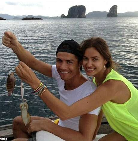 Cristiano Ronaldo holds up the fish he caught while on holiday in Thailand with girlfriend and swimsuit model Irina Shayk.