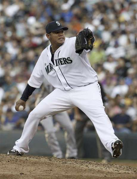 Seattle Mariners' Felix Hernandez delivers a pitch in the fifth inning against the Texas Rangers during their MLB American League game in Seattle, Washington July 14, 2012.
