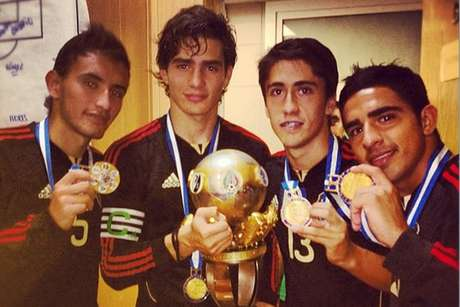 Members of the Mexican U-20 soccer team with the championship trophy.