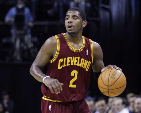 In this April 23, 2012, photo, Cleveland Cavaliers' Kyrie Irving brings the ball up during NBA basketball game against the Memphis Grizzlies in Memphis, Tenn. Irving broke his right hand during a practice in Las Vegas and could be sidelined for two months, the team said Saturday, July 14, 2012.