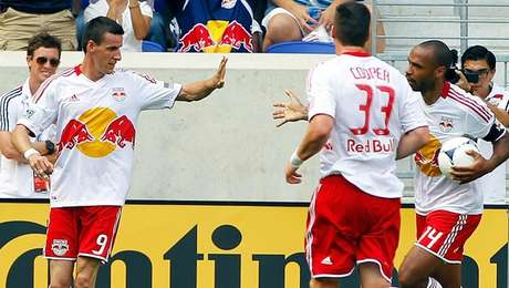 Sebastien Le Toux (left) is congratulated after scoring his first goal as a member of the New York Red Bulls in a 2-2 draw against Seattle Sunday.