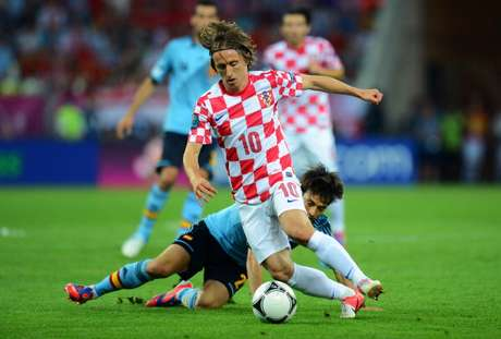Luka Modric of Croatia gets the better of David Silva of Spain during the UEFA EURO 2012 group C match between Croatia and Spain at The Municipal Stadium on June 18, 2012 in Gdansk, Poland.