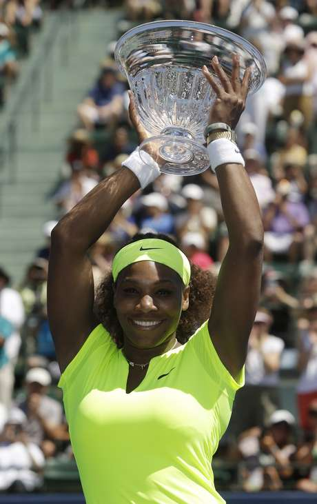 Serena Williams, of the United States, holds the winner's trophy after defeating Coco Vandeweghe, of the United States, during the final of the Bank of the West tennis tournament on Sunday, July 15, 2012, in Stanford, Calif. Williams won 7-5, 6-3.