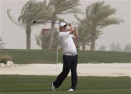 Richard Finch of Britain hits a fairway shot on the 15th hole during the first round of the Qatar Masters tournament at the Doha golf club in Doha February 2, 2012.