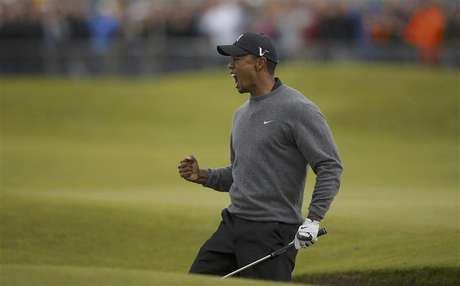 Tiger Woods of the U.S. reacts after chipping in from a bunker to make birdie during the second round of the British Open golf championship at Royal Lytham & St Annes, northern England July 20, 2012.