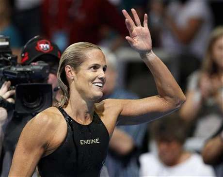 Dara Torres waves to her family after failing to qualify in the women's 50m freestyle race during the U.S. Olympic swimming trials in Omaha, Nebraska, July 2, 2012.