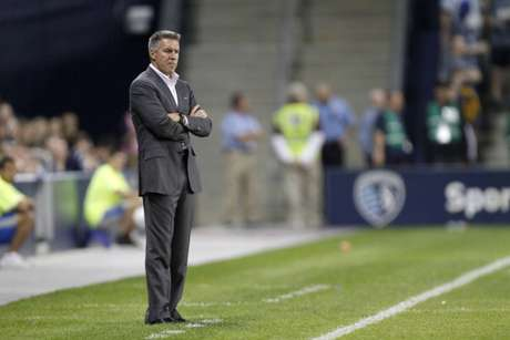 Peter Vermes, head coach of the Sporting Kansas City, watches his team play against New England Revolution at Livestrong Sporting Park on March 17, 2012 in Kansas City, Kansas.