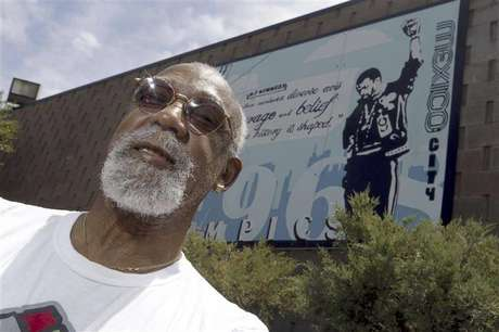 John Carlos, participant of the 1968 Olympics, stands in front of a mural made by students on the campus, at Palm Springs High School, where he is a teacher and counsellor in Palm Springs, California July 11, 2012. Picture taken July 11, 2012.