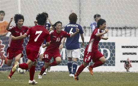 North Korea's Kim Jo Ran (R) celebrates after scoring against Japan at the women's qualifying tournament for the 2012 Olympic Games in Jinan, Shandong province, in this September 8, 2011 file photo.