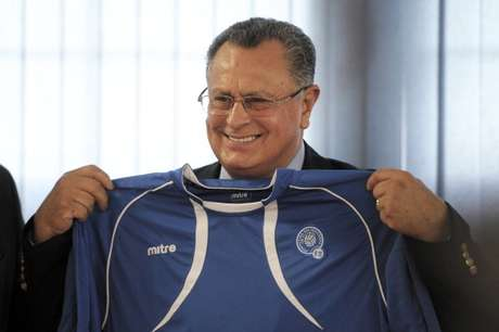 Mexican Juan De Dios Castillo poses with a Salvadorean national football team jersey during a press conference during which he was presented as their new coach by the Salvadorean Football Federation, in San Salvador, on July 19, 2011.