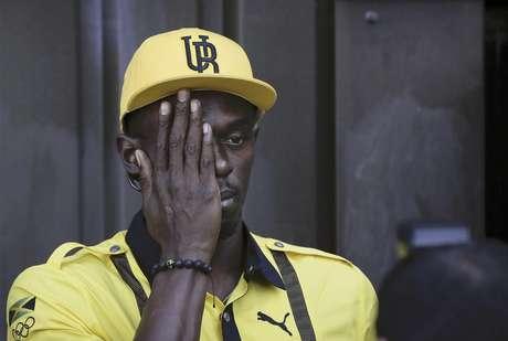 El velocista jamaicano Usain Bolt posa para un fotógrafo tras una conferencia de prensa el jueves, 26 de julio de 2012, en la antesala de los Juegos Olímpicos de Londres.