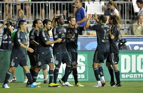 Eddie Johnson #9 of MLS All-Stars celebrates with teammates after a go-ahead goal late in the second half against Chelsea during the 2012 AT&T MLS All-Star Game at PPL Park on July 25, 2012 in Chester, Pennsylvania.