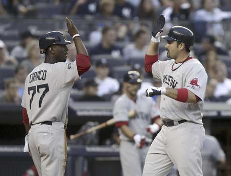 Adrian Gonzalez (right) congratulates Pedro Ciriaco after he scored the final run in Boston's 8-6 win over the New York Yankees Saturday night.