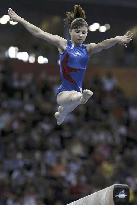 Uzbekistan's Luiza Galiulina competes in the women's balance beam final during artistic gymnastics at the 16th Asian Games in Guangzhou, Guangdong province, in this November 17, 2010 file photo. Galiulina was on July 29, 2012 provisionally banned from the 2012 Olympics for a positive drugs test, the International Olympic Committee said on Sunday.
