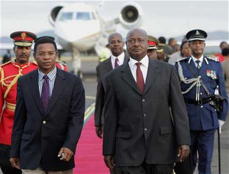 Uganda's President Yoweri Museveni (R) is escorted by Tanzanian Foreign Affairs minister Bernard Membe (L) upon arrival at Kilimanjaro Airport in Tanzania, May 21, 2008.