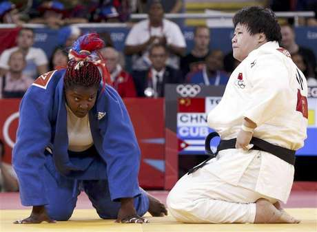 Gold medallist Cuba's Idalys Ortiz jumps at the victory ceremony for the women's +78kg judo event at the London 2012 Olympic Games August 3, 2012.