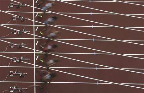 Athletes start off in the women's heptathlon 100m hurdles heat during the London 2012 Olympic Games at the Olympic Stadium August 3, 2012.