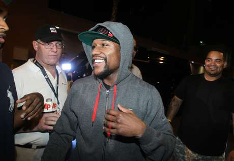 Floyd Mayweather Jr., exits the Clark County Detention Center after serving two months of a three-month sentence in a misdemeanor domestic battery case, Friday, Aug. 3, 2012, in Las Vegas.