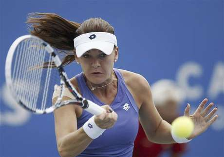 Agnieszka Radwanska of Poland hits a return during her match against Mona Barthel of Germany at the Rogers Cup tennis tournament in Montreal, August 9, 2012.