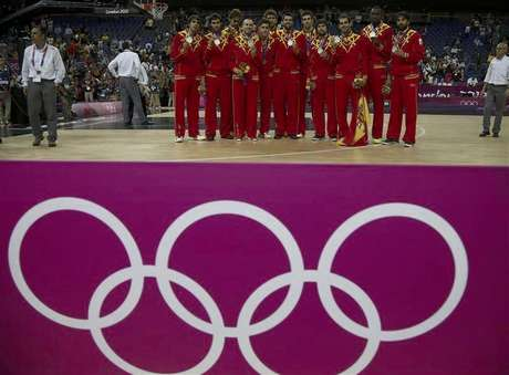 Spain's players pose with their silver medals during victory ceremony at the North Greenwich Arena during the London 2012 Olympic Games August 12, 2012.