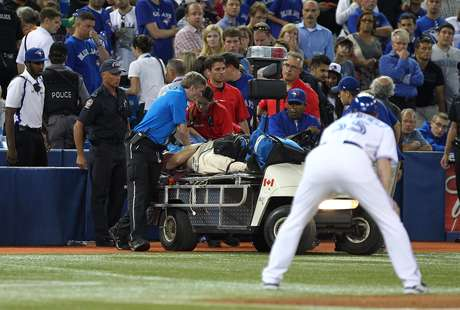 Paramedics tend to a fan during the MLB game between the Chicago White Sox and Toronto Blue Jays.