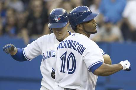 Toronto Blue Jay's Edwin Encarnacion celebrates during the win against the Rangers.