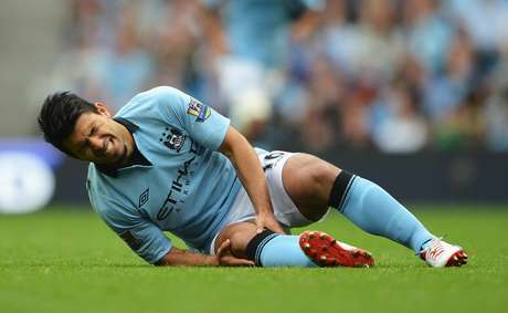 Sergio Aguero in pain after injuring his knee