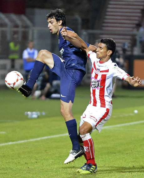 Paris Saint-Germain's Javier Pastore (L) challenges Ajaccio's Benjamin Andre during their French Ligue 1 soccer match in Ajaccio August 19, 2012.  REUTERS/Pierre Murati (FRANCE - Tags: SPORT SOCCER)
