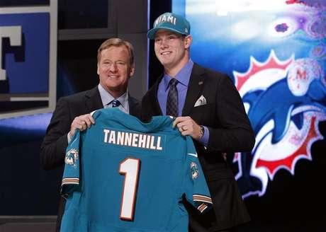 Ryan Tannehill from Texas A&M University holds up a jersey as he stands with NFL Commissioner Roger Goodell after being selected by the Miami Dolphins as the eighth overall pick in the 2012 NFL Draft in New York, April 26, 2012.