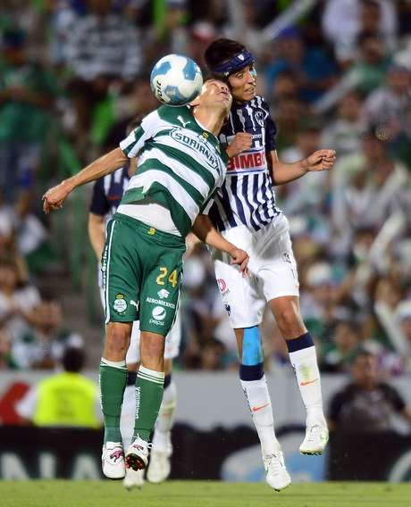 Oribe Peralta (L) of Santos vies for the ball with Jesus Zavala (R) of Monterrey, during their Mexican Clausura 2012 tournament football final match, in Torreon, Coahuila State, Mexico on May 20, 2012.