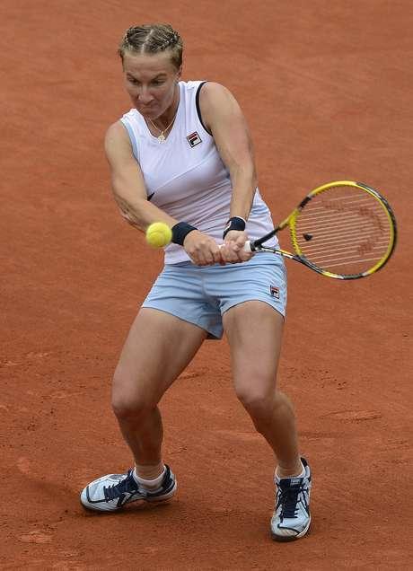 Russia's Svetlana Kuznetsova hits a return to Italy's Sara Errani during their Women's Singles 4th Round tennis match of the French Open tennis tournament at the Roland Garros stadium, on June 3, 2012 in Paris.