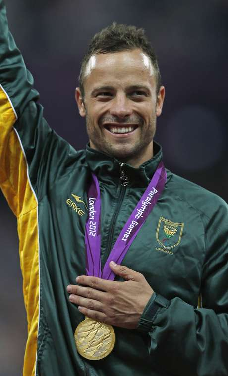 South Africa's Oscar Pistorius celebrates with his gold medal after winning the men's 400m T44 classification at the Olympic Stadium during the London 2012 Paralympic Games September 8.