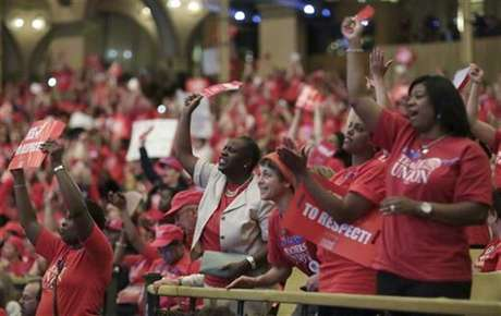 Thousands of Chicago Public School teachers rally before marching to the Board of Education's headquarters in Chicago, May 23, 2012.