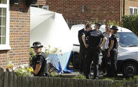 Army and police personnel stand outside the home of Saad al-Hilli in Claygate, south of London September 10, 2012. Police searching the home of a British family found shot dead in the French Alps last week evacuated neighbouring properties on Monday after saying they had discovered unspecified items that had caused them concern.