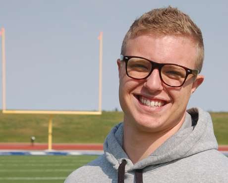 Jamie Kuntz poses for a photograph at a football field in Dickinson, N.D., on Tuesday, Sept. 11, 2012. Kuntz says he was kicked of the North Dakota State College of Science football team for being gay. School officials say he was dismissed from the team for lying to a coach.
