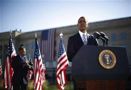 U.S. President Barack Obama speaks near U.S. Secretary of Defense Leon Panetta on the 11th anniversary of the September 11 attacks at the Pentagon near Washington, September 11, 2012.