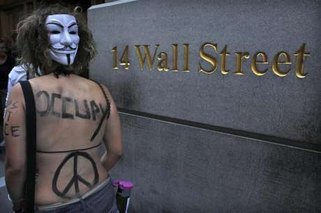 An Occupy Wall Street activist takes part in a march in downtown Manhattan in New York July 11, 2012.