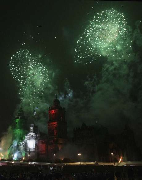 "Fireworks explode in the sky as thousands of Mexicans celebrate the 202nd anniversary of their independence from Spain in Mexico City September 15, 2012. Mexican President Felipe Calderon shouted the ""Cry of Independence"" at the National Palace, echoing the cry by priest Miguel Hidalgo used to launch the revolution in 1810."