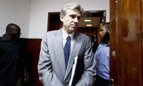 Christopher Stevens, the U.S. ambassador to Libya, leaves after a meeting with Libya's Justice Minister Ali Ashour discussing cooperation between the two countries on issues of human rights, in Tripoli June 27, 2012. Stevens and three embassy staff were killed late on September 11, 2012, as they rushed away from a consulate building in Benghazi, stormed by al Qaeda-linked gunmen blaming America for a film that they said insulted the Prophet Mohammad. Stevens was trying to leave the consulate building for a