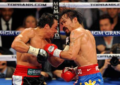 """""""Pacman"""" Pacquiao y """"Dinamita"""" Márquez pelearán el próximo 8 de diciembre en el MGM Grand Garden Arena de Las Vegas."""