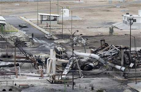 Burnt cars and gas storage tanks are seen at a gas facility of Pemex in Reynosa, September 18, 2012.