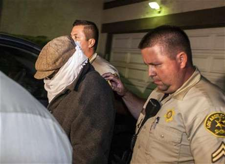 Nakoula Basseley Nakoula (L) is escorted out of his home by Los Angeles County Sheriff's officers in Cerritos, California September 15, 2012.