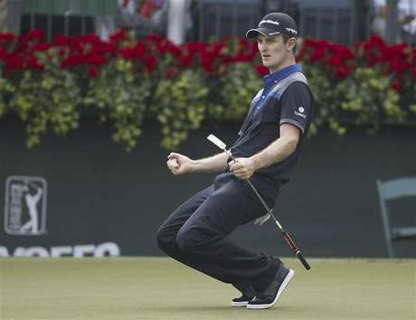 Justin Rose of England reacts after a birdie putt on the 18th hole during the first round of the Tour Championship golf tournament at the East Lake Golf Club in Atlanta, Georgia September 20, 2012.