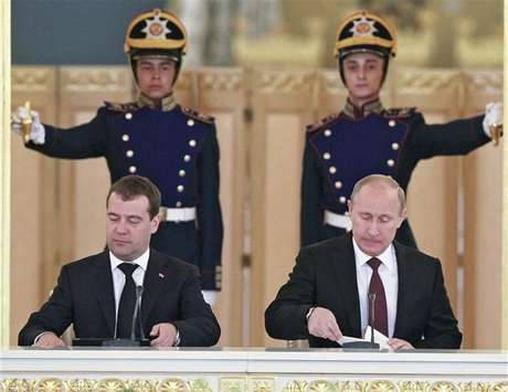 Russia's President Vladimir Putin (R) and Prime Minister Dmitry Medvedev attend a session of the State Council at the Kremlin in Moscow, July 17, 2012.