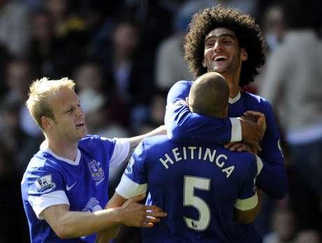 Everton's Marouane Fellaini celebrates scoring a goal with teammate John Heitinga.