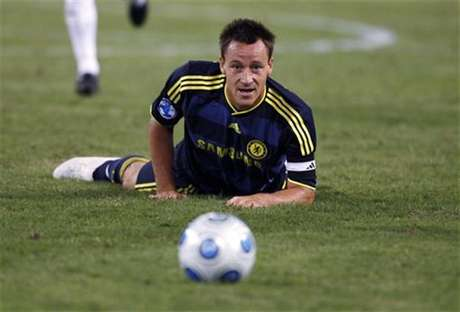 Chelsea's John Terry keeps his eyes on the ball as he falls on the pitch during the second half of their 2009 World Football Challenge soccer match against AC Milan in Baltimore, Maryland, July 24, 2009.