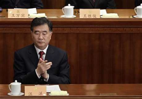 Wang Yang, Party Secretary of the Guangdong Province, claps during the opening ceremony of the Chinese People's Political Consultative Conference (CPPCC) at the Great Hall of the People in Beijing March 3, 2012.